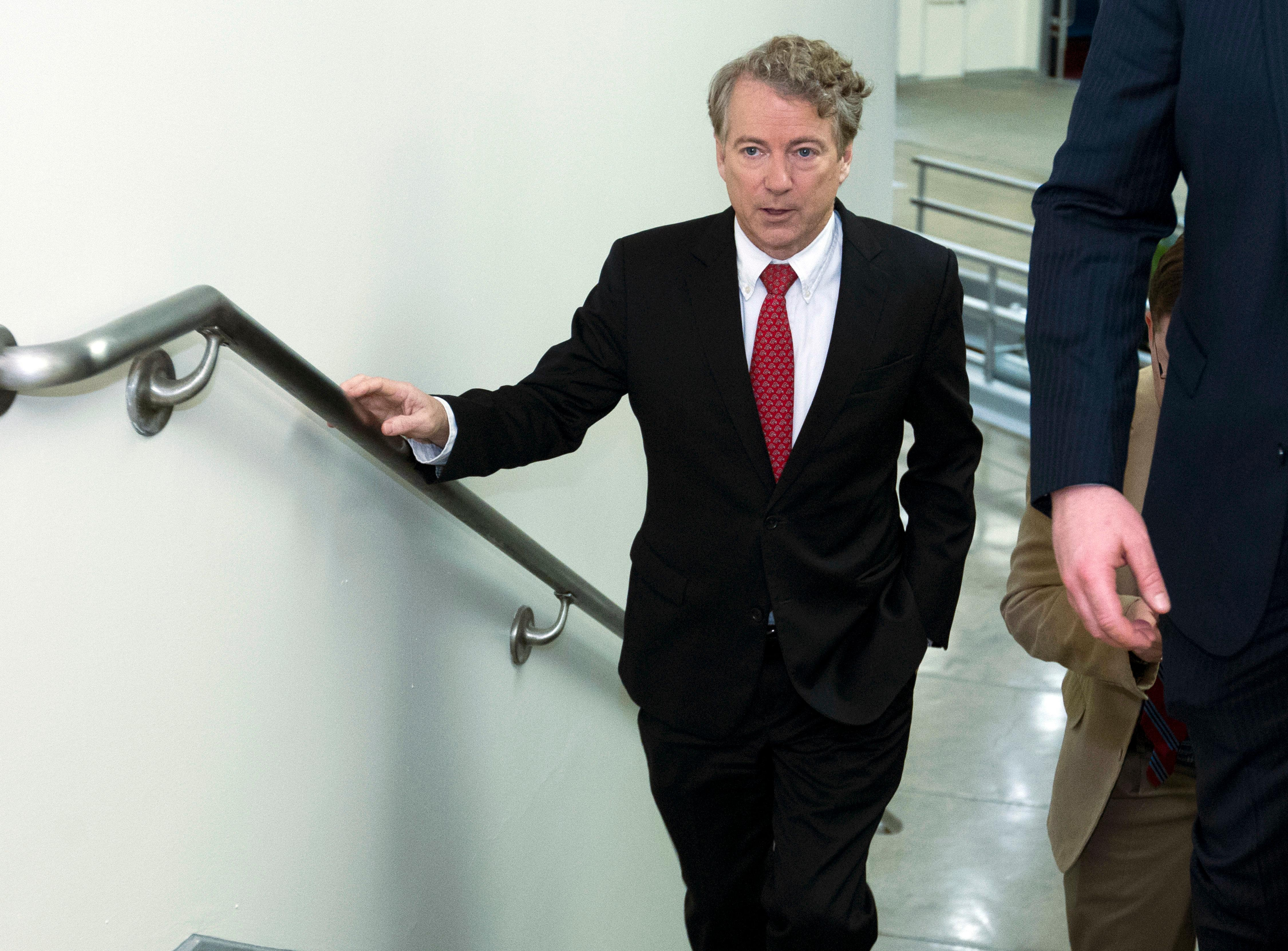 Sen. Rand Paul, R-Ky., walks to the Senate chamber, at the U.S. Capitol, Thursday, Feb. 8, 2018, in Washington.(AP Photo/Jose Luis Magana)
