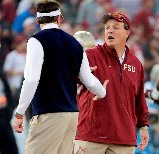 Florida State head coach Jimbo Fisher shakes hands with Auburn head coach Gus Malzahn before the NCAA BCS National Championship college football game Monday, Jan. 6, 2014, in Pasadena, Calif.