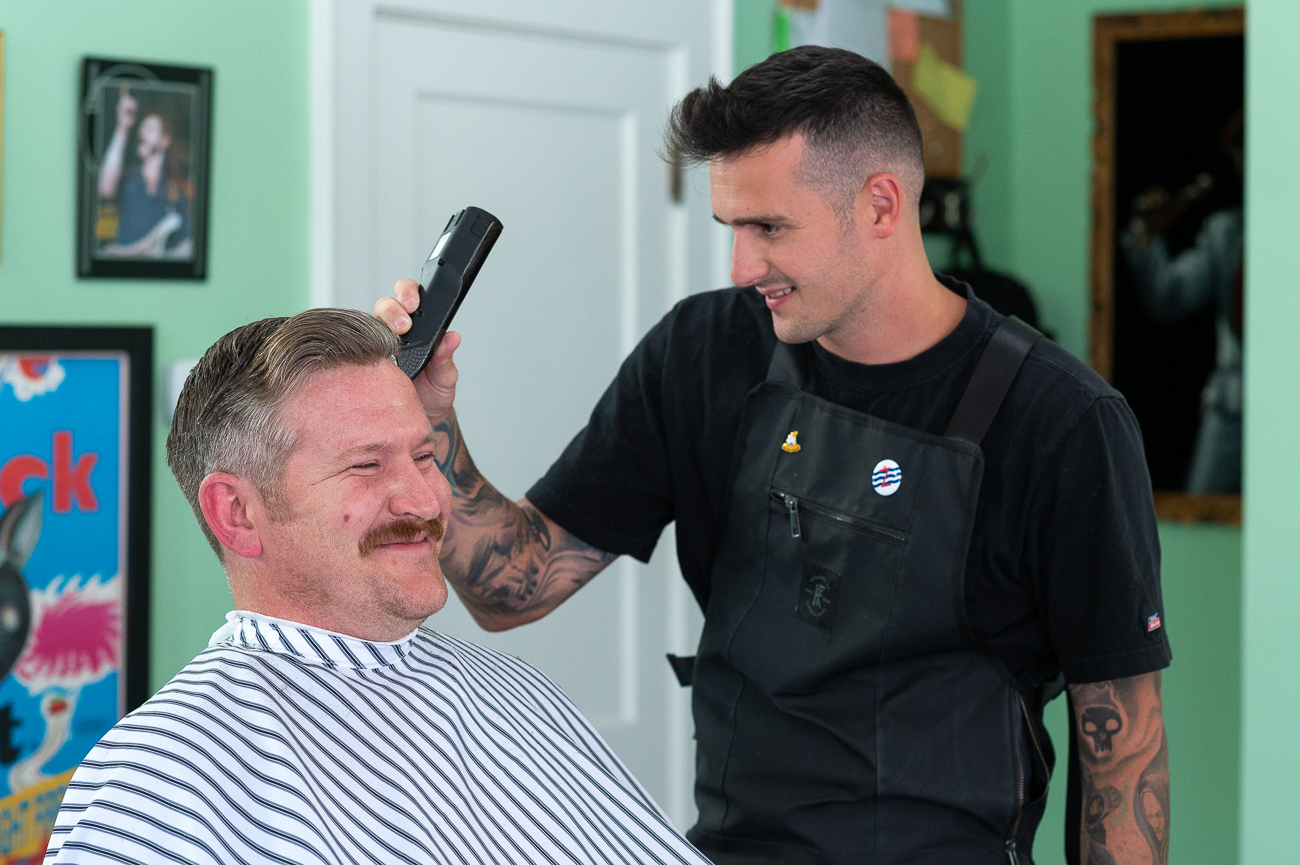 Chris is joined by two other barbers: Konnor Kindle and Seth Kirby. The three of them make up the entirety of the shop's staff. / Image: Phil Armstrong, Cincinnati Refined // Published: 7.10.20