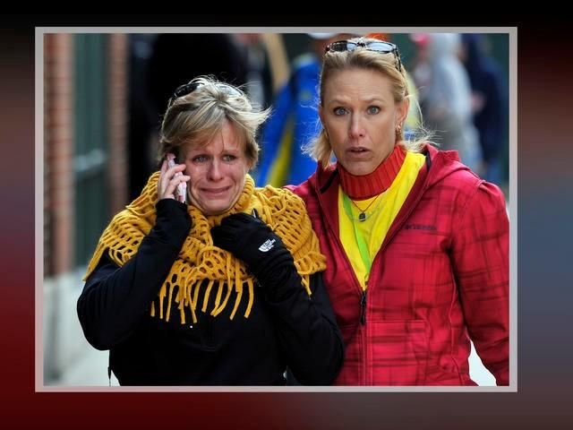 Women react after explosions near the finish line of the 2013 Boston Marathon.