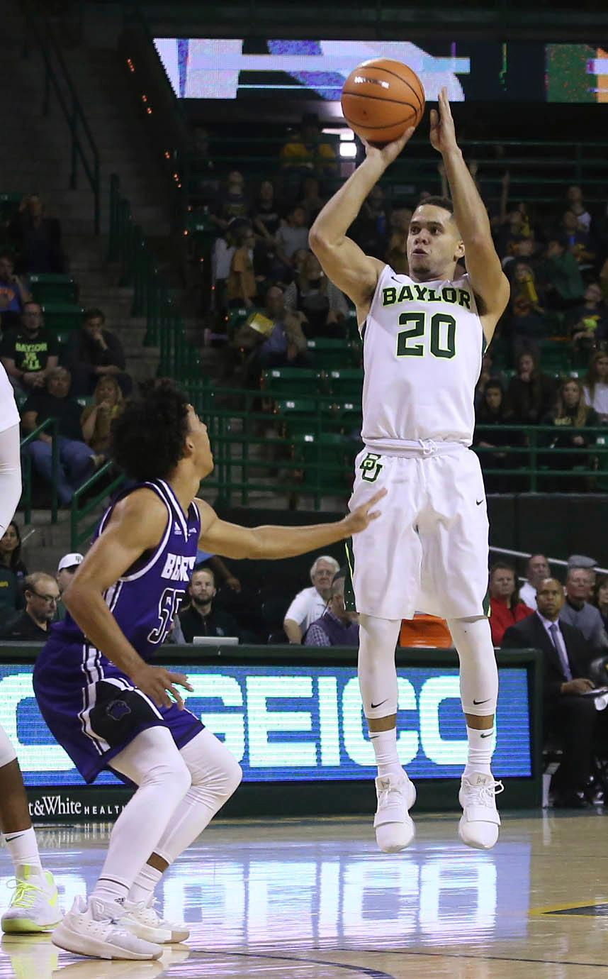 Baylor guard Manu Lecomte (20) shoots from three-point range over Central Arkansas guard Deandre Jones (55) in the second half of a NCAA college basketball game, Friday, Nov. 10, 2017, in Waco, Tx. Baylor won 107-66. (AP Photo/Jerry Larson)