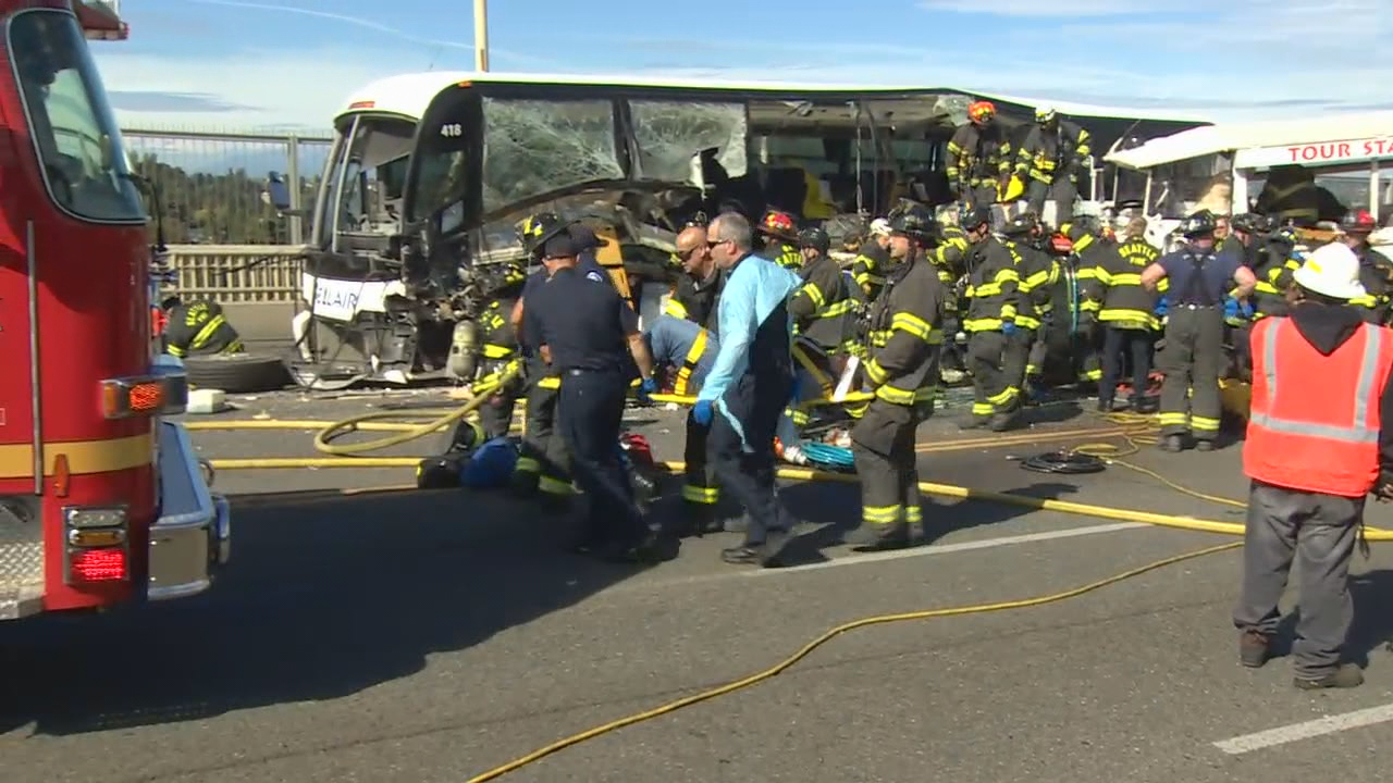 Five students were killed when the Ride the Ducks vehicle crossed the center line of the bridge and slammed head on into a bus carrying North Seattle Colleges students. KOMO News photo