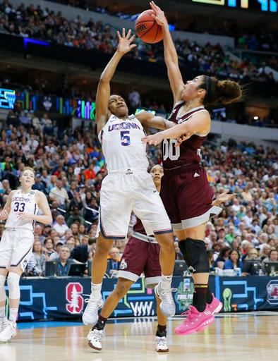 Connecticut guard Crystal Dangerfield (5) is blocked by Mississippi State guard Jazzmun Holmes (10) during the first half of an NCAA college basketball game in the semifinals of the women's Final Four, Friday, March 31, 2017, Friday, March 31, 2017, in Dallas. (AP Photo/Tony Gutierrez)