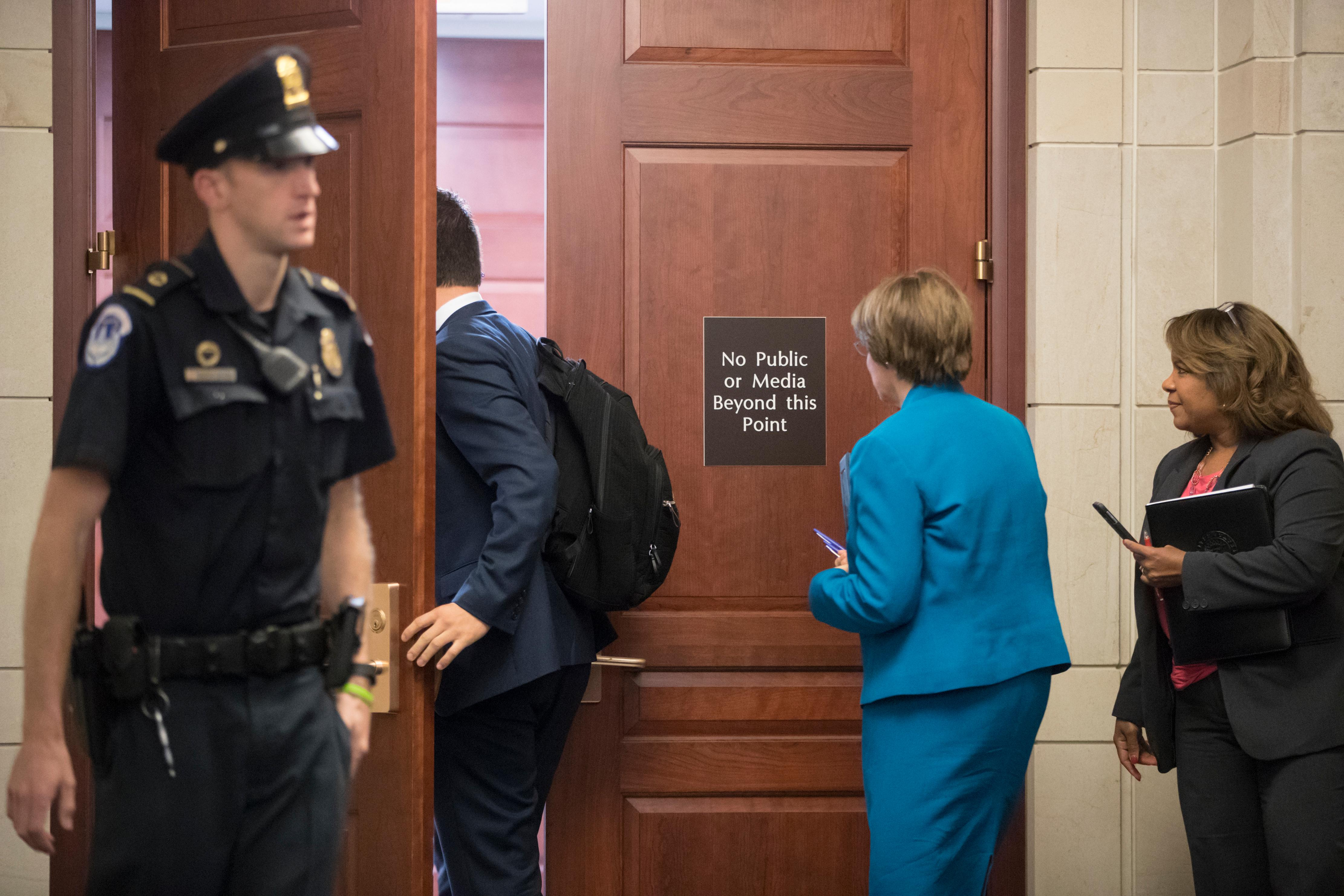 Sen. Amy Klobuchar, D-Minn., second from right, a member of the Senate Judiciary Committee, leaves a closed-door interview with Donald Trump Jr., as the panel investigates the meddling and possible Russian links to President Donald Trump's 2016 presidential campaign, at the Capitol in Washington, Thursday, Sept. 7, 2017.  (AP Photo/J. Scott Applewhite)