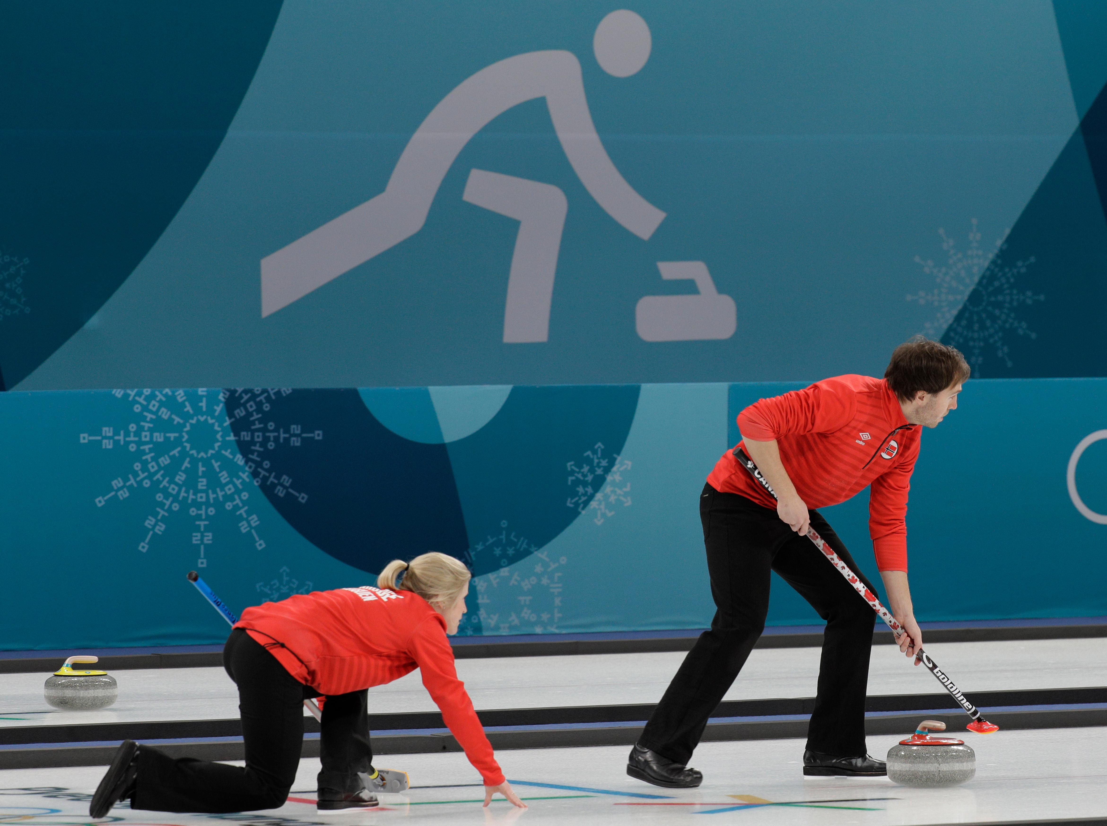 Norway's Kristin Skaslien, left, the Curling mixed doubles training session ahead of the 2018 Winter Olympics in Gangneung, South Korea, Wednesday, Feb. 7, 2018. (AP Photo/Aaron Favila)