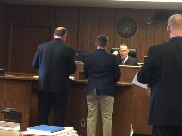 Brendon Clevenger, center, listens to the judge during his pleading in Kalamazoo County Circuit Court on Thursday, Dec. 14, 2017. (WWMT/Jessica Wheeler)<p></p>