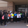 Teachers and students stand in protest of state budget cuts and teacher pay