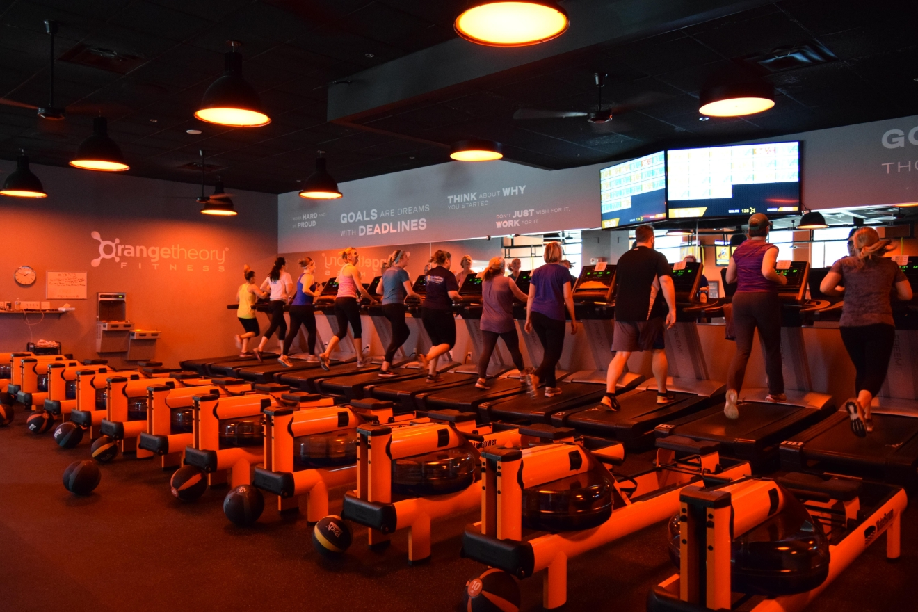 Classes combine time on treadmills, rowers and the weight floor, all while students wear heart rate monitors to stay on top of their efforts. (Image: Tina Irizarry)