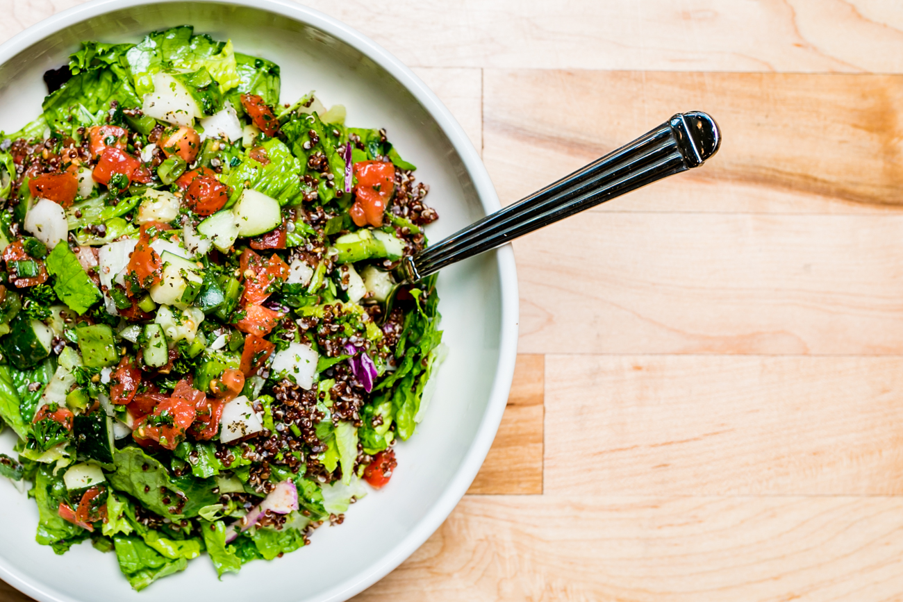 <p>Red Quinoa Lebanese Salata:{&amp;nbsp;}Chopped tomatoes, cucumbers, green peppers, scallions, onions, and parsley tossed with red quinoa, extra virgin olive oil and lemon juice on a bed of greens / Image: Amy Elisabeth Spasoff // Published: 7.19.18</p>