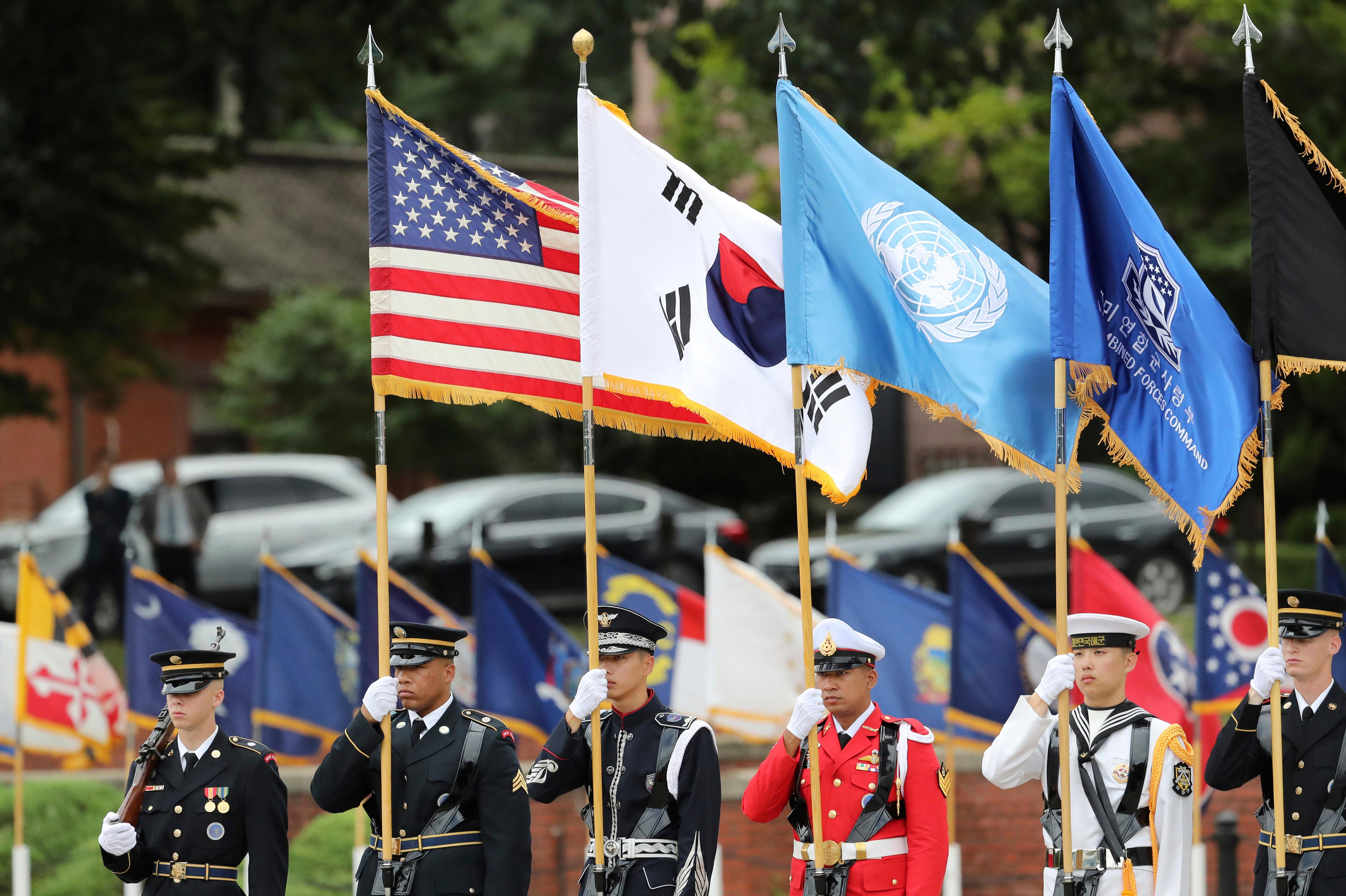 U.N. Command honor guards carry flags of the United States, the United Nations and South Korea during a change of command and change of responsibility ceremony for Deputy Commander of the South Korea-U.S. Combined Force Command at Yongsan Garrison, a U.S. military base, in Seoul, South Korea, Friday, Aug. 11, 2017. (AP Photo/Lee Jin-man)
