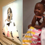 Little girl who was entranced by Michelle Obama's portrait dresses like her for Halloween