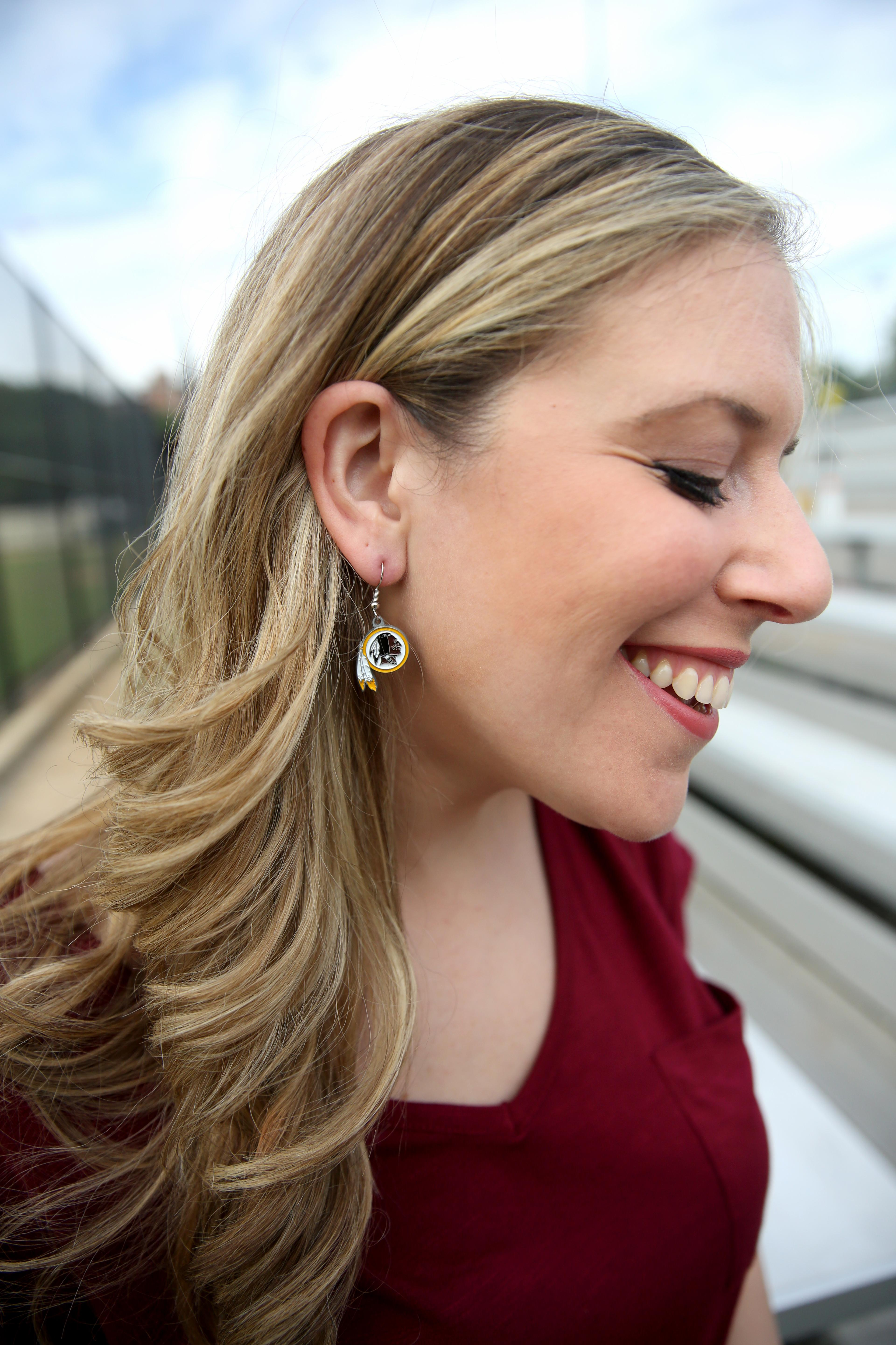 To give it that football vibe, I've accessorized with some pretty funny additions such as redskins earrings (they make these for all the NFL teams) and a pair of flats that match. (Image: Amanda Andrade-Rhoades/ DC Refined)