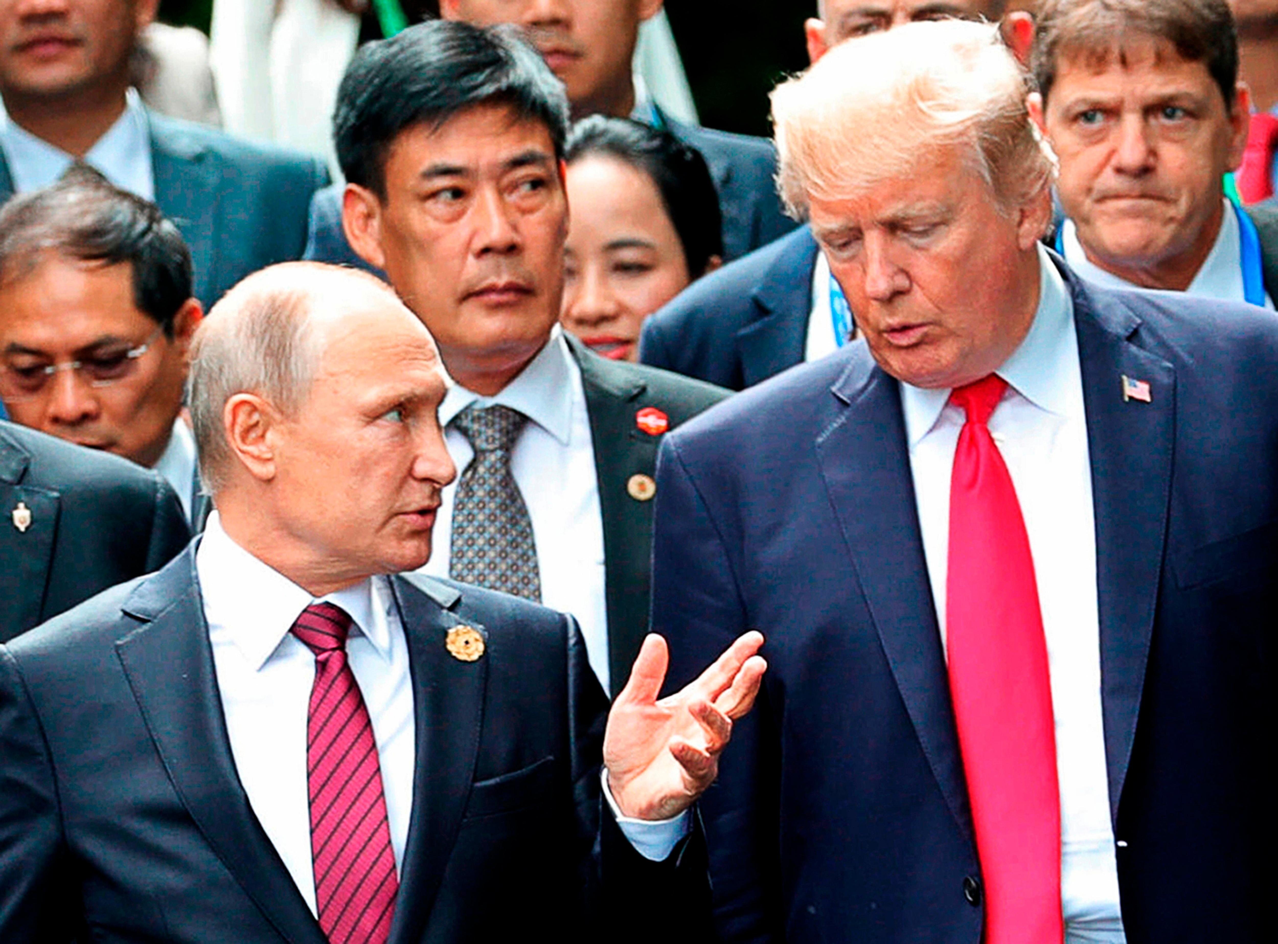 FILE - In this Nov. 11, 2017, file photo,  President Donald Trump, right, and Russia President Vladimir Putin talk during the family photo session at the APEC Summit in Danang. The Trump administration is opening the door to a potential White House meeting between Trump and Putin. It would be the first time Putin has been at the White House in more than a decade and come at a time of rising tensions between the two global powers. (Mikhail Klimentyev, Sputnik, Kremlin Pool Photo via AP)