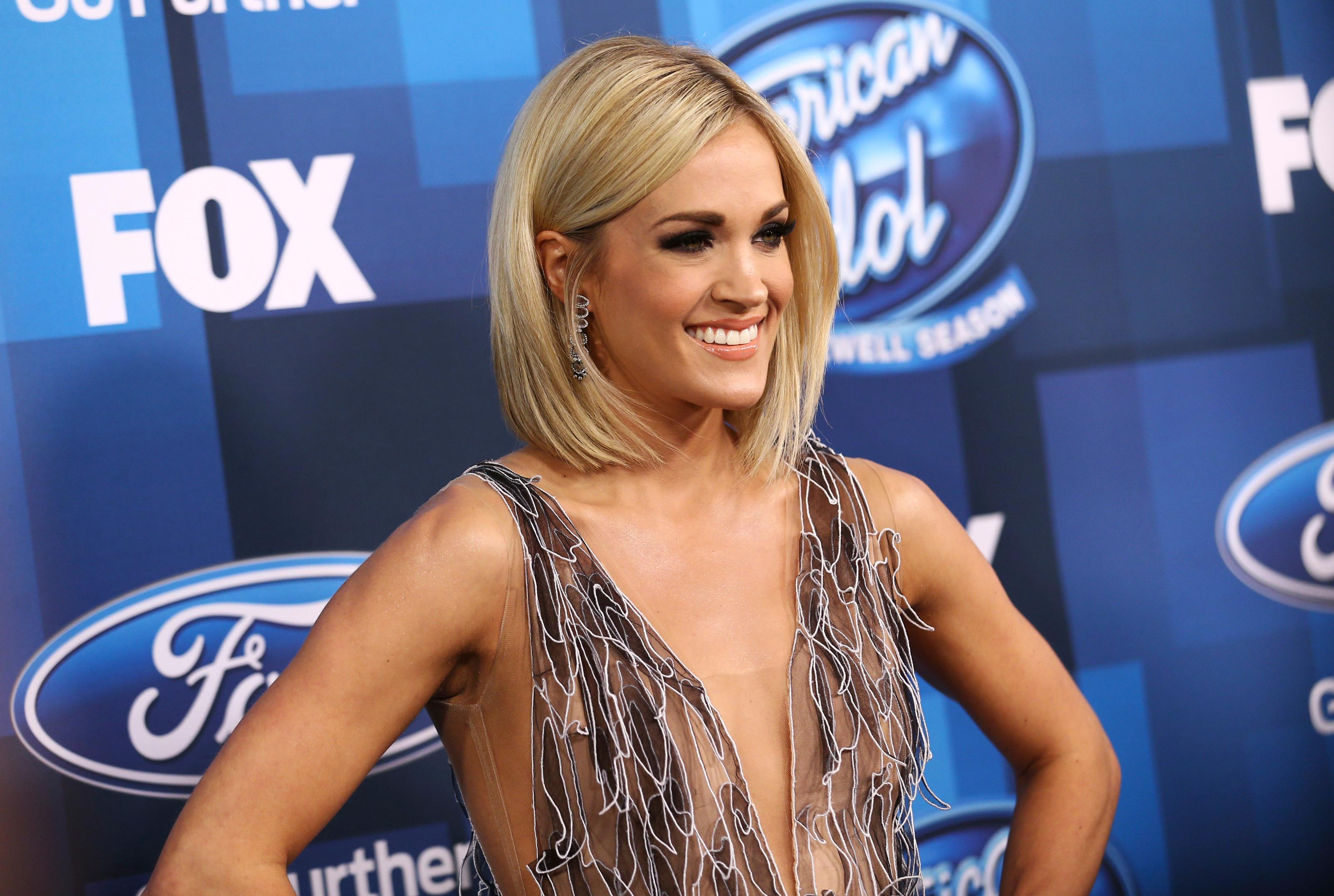 "FILE - In this Thursday, April 7, 2016, file photo, Carrie Underwood arrives at the ""American Idol"" farewell season finale at the Dolby Theatre in Los Angeles. ABC said it will revive ""American Idol"" after it has spent only one year off the air. The network announced Tuesday, May 9, 2017, that the music competition show that dominated television in the 2000s and minted stars like Underwood, Jennifer Hudson and Kelly Clarkson, will begin sometime in the next TV season. That season starts in September 2017. (Photo by John Salangsang/Invision/AP, File)"