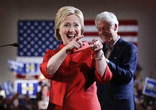 Democratic presidential candidate Hillary Clinton, left, greets supporters with her husband and former President Bill Clinton at a Nevada Democratic caucus rally, Saturday, Feb. 20, 2016, in Las Vegas. (AP Photo/John Locher)