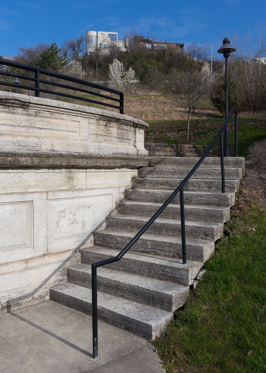 Curved stairs, cut from the same limestone as the arch, lead to a terrace that once featured a fountain long ago. / Image: Phil Armstrong, Cincinnati Refined // Published: 4.13.18