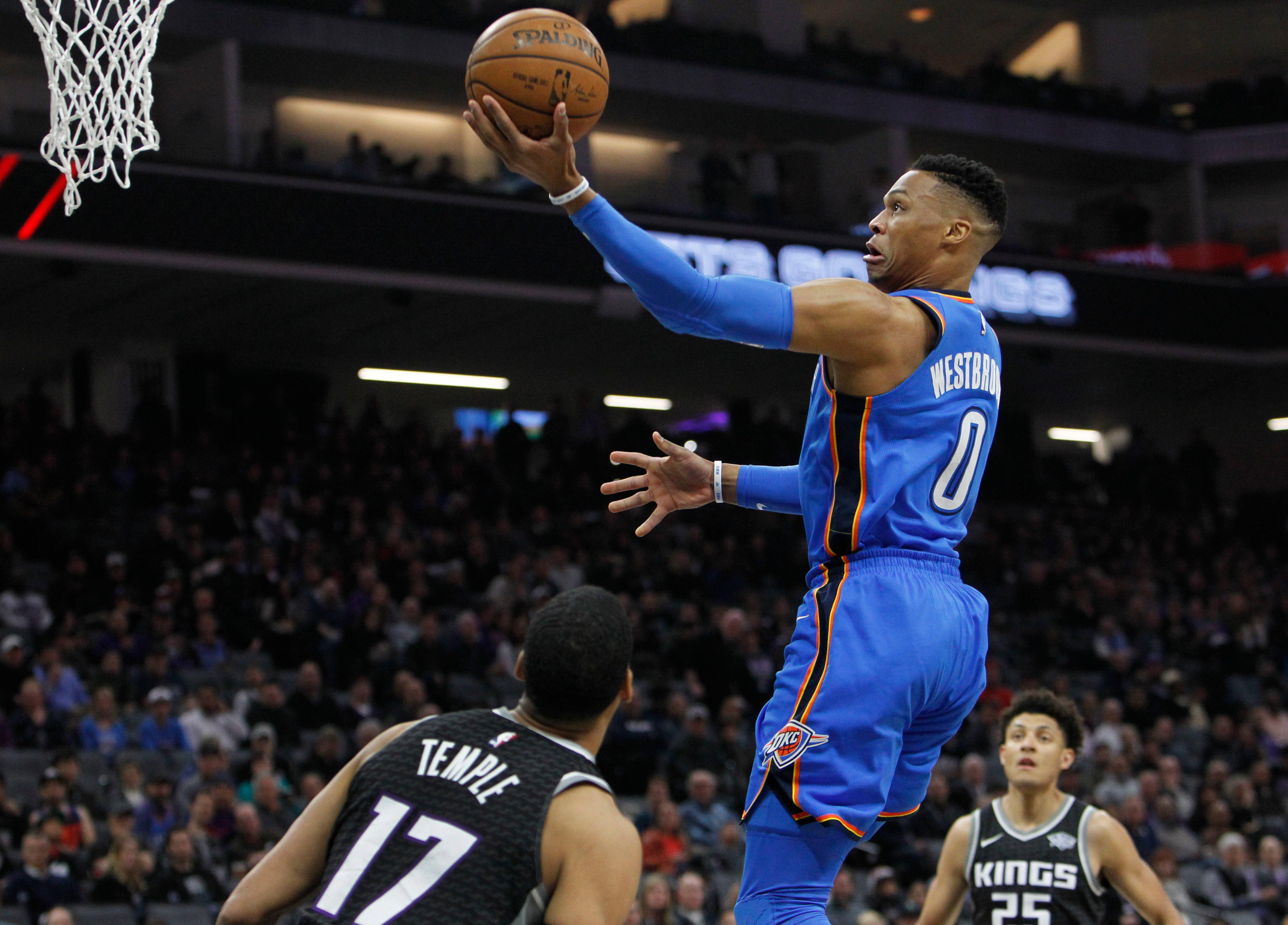 Oklahoma City Thunder guard Russell Westbrook (0) drives to the basket against Sacramento Kings guard Garrett Temple (17) during the first half of an NBA basketball game in Sacramento, Calif., Thursday, Feb. 22, 2018. (AP Photo/Steve Yeater)