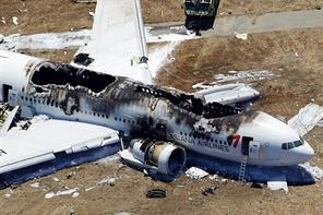 This aerial photo shows the wreckage of the Asiana Flight 214 airplane after it crashed at the San Francisco International Airport, Saturday. (AP Photo/Marcio Jose Sanchez)