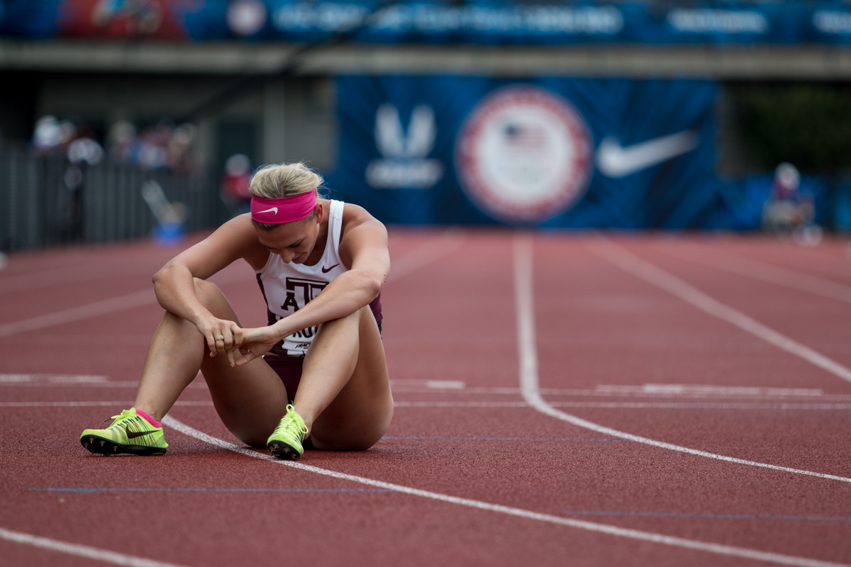 Annie Kunz of Texas A&M rests on the track after the final event of the heptathlon. She placed 8th overall after two days of competition. Day Ten of the U.S. Olympic Trials Track and Field concluded on Sunday at Hayward Field in Eugene, Ore. Competition lasted July 1 - July 10. Photo by Dillon Vibes