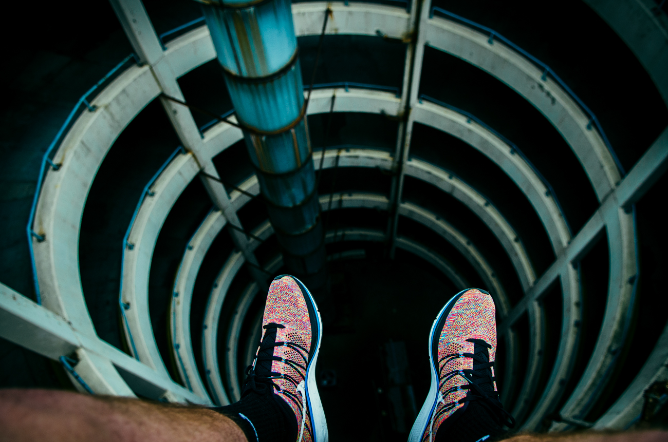 My first love, sneakers. Looking down the spiral at soon-to-be defunct Pogue's Garage. August 16, 2014 / Image: Corey Stevens