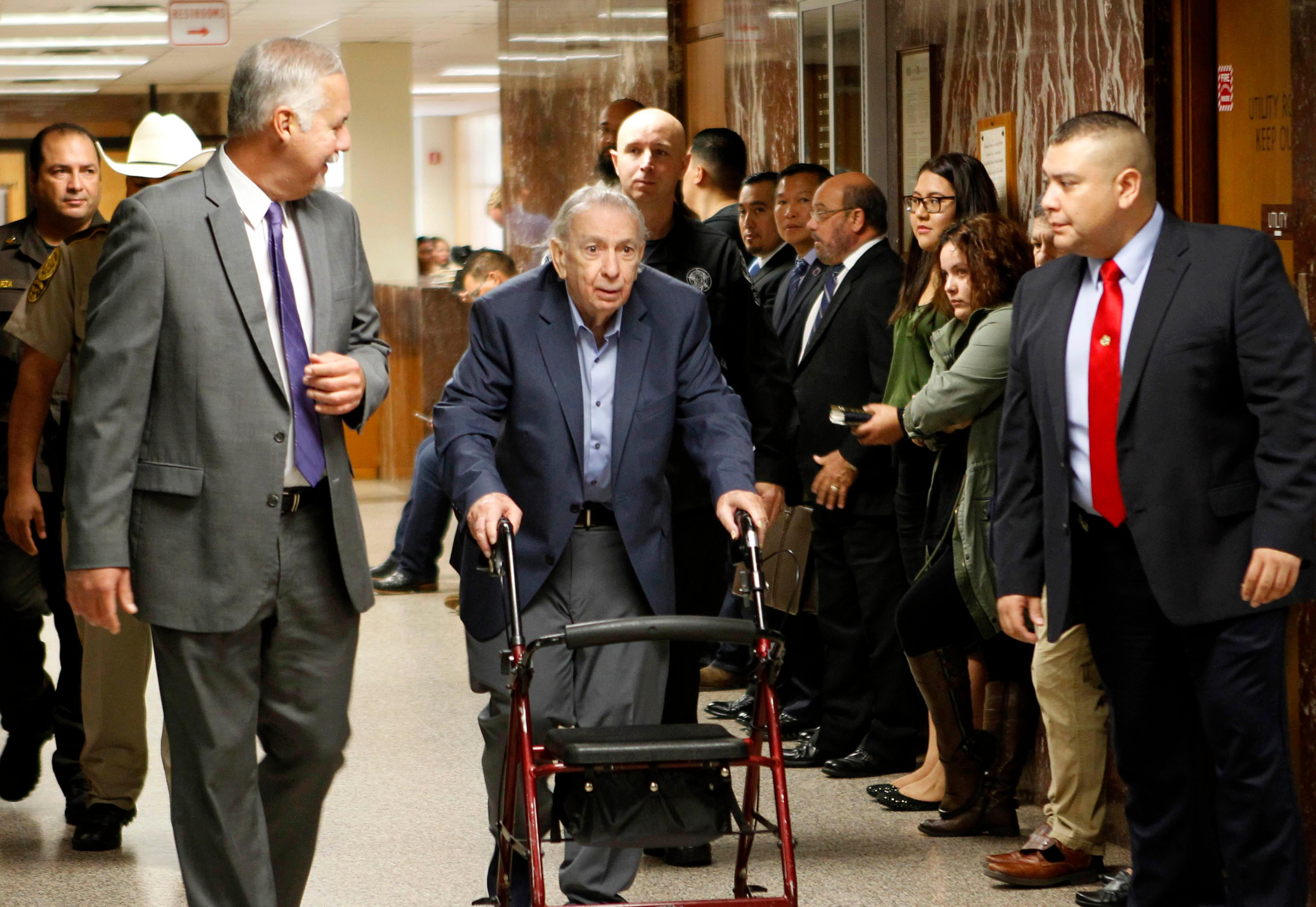 John Bernard Feit walks down the hallway to the 92nd state District Court for the fourth day of his trial for the murder of Irene Garza Tuesday, December 5, 2017, at the Hidalgo County Courthouse in Edinburg.  (Nathan Lambrecht/The Monitor/Pool)
