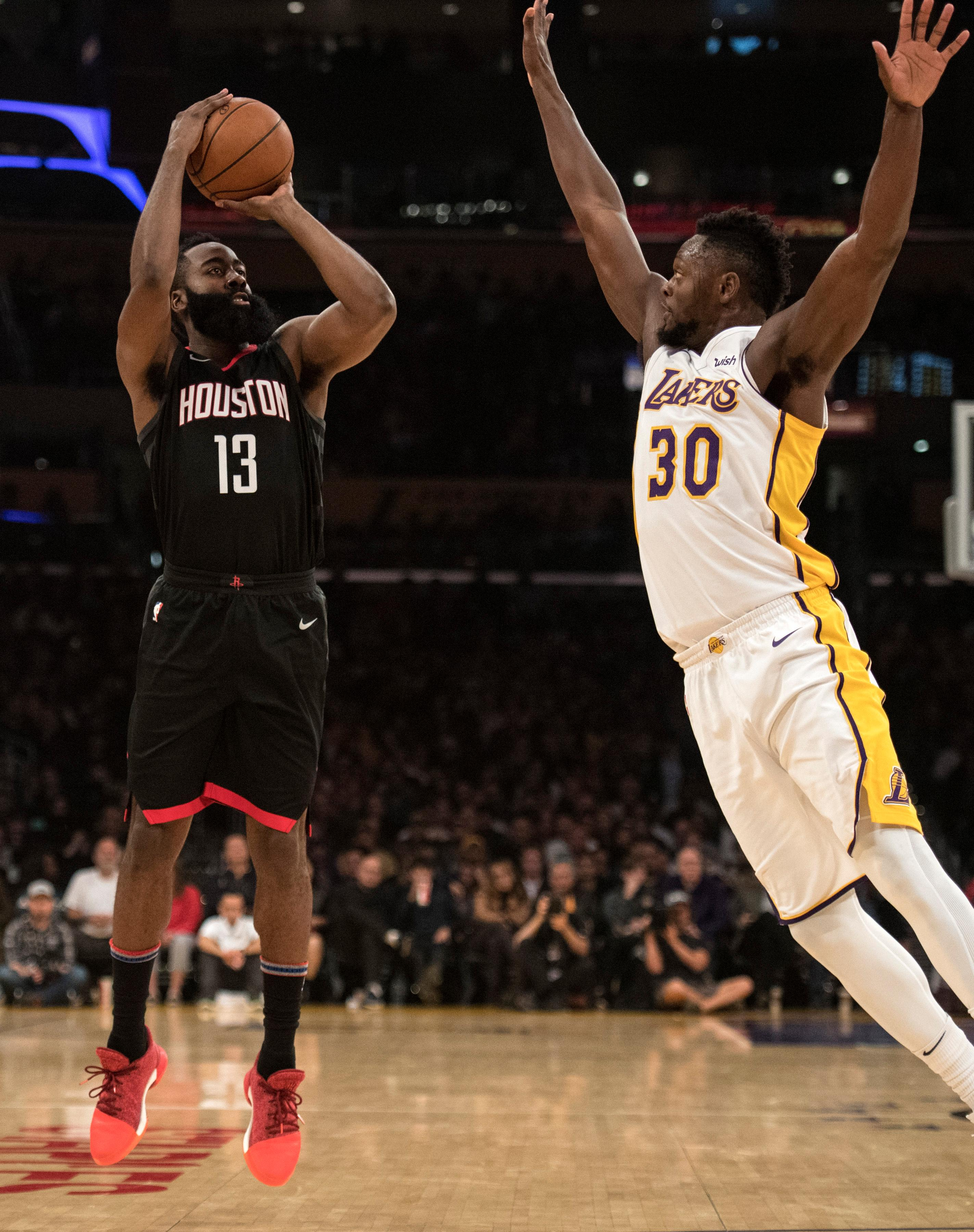 Houston Rockets guard James Harden shoots a 3-pointer over Los Angeles Lakers forward Julius Randle (30) during the first half of an NBA basketball game Sunday, Dec. 3, 2017, in Los Angeles. (AP Photo/Kyusung Gong)