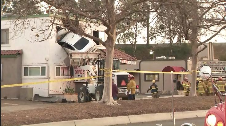 A car flew into the second floor of a building in Santa  Ana, California. (CNN Newsource)