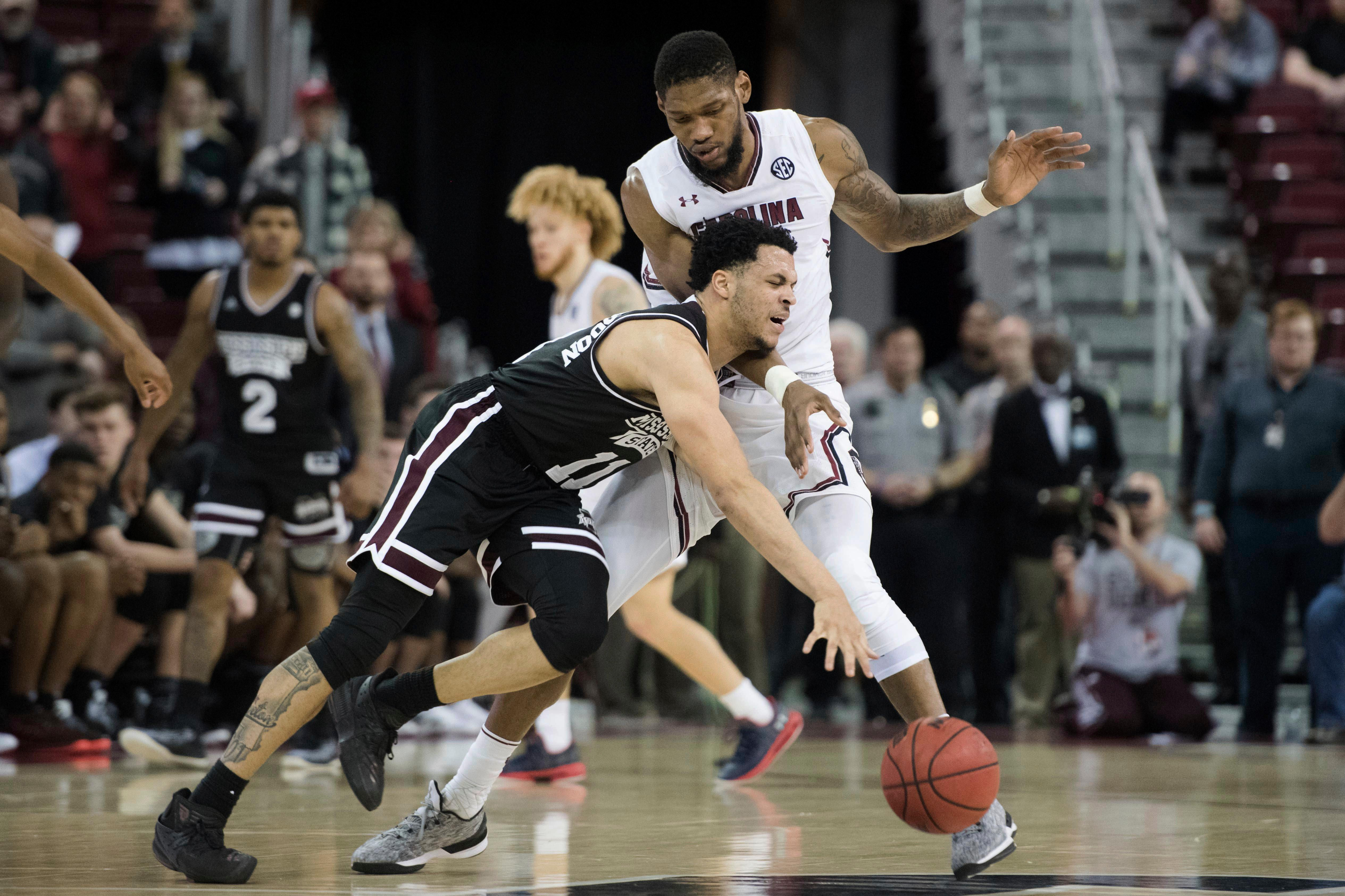 Mississippi State guard Quinndary Weatherspoon (11) is defended by South Carolina forward Chris Silva during the second half of an NCAA college basketball game Tuesday, Jan. 8, 2019, in Columbia, S.C. South Carolina won 87-82. (AP Photo/Sean Rayford)
