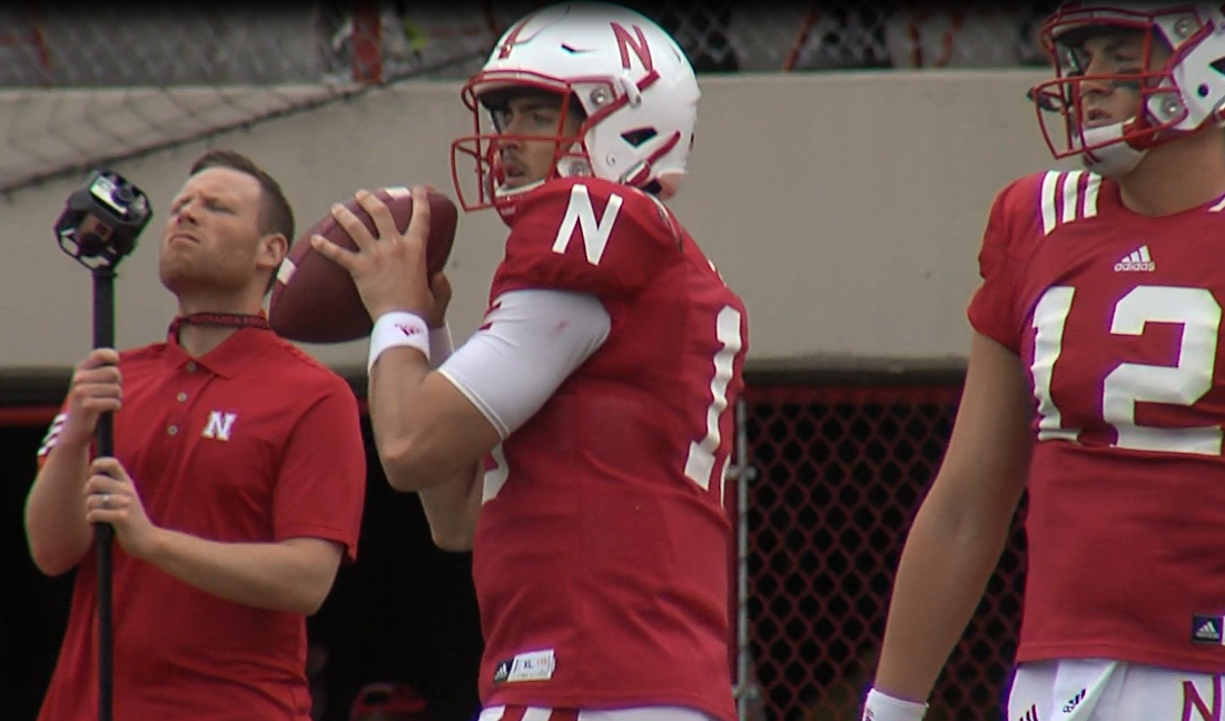 Nebraska junior quarterback Tanner Lee (middle) warms-up as Patrick O'Brien (12) looks on prior to the Red-White spring game, April 15, 2017 (NTV News)