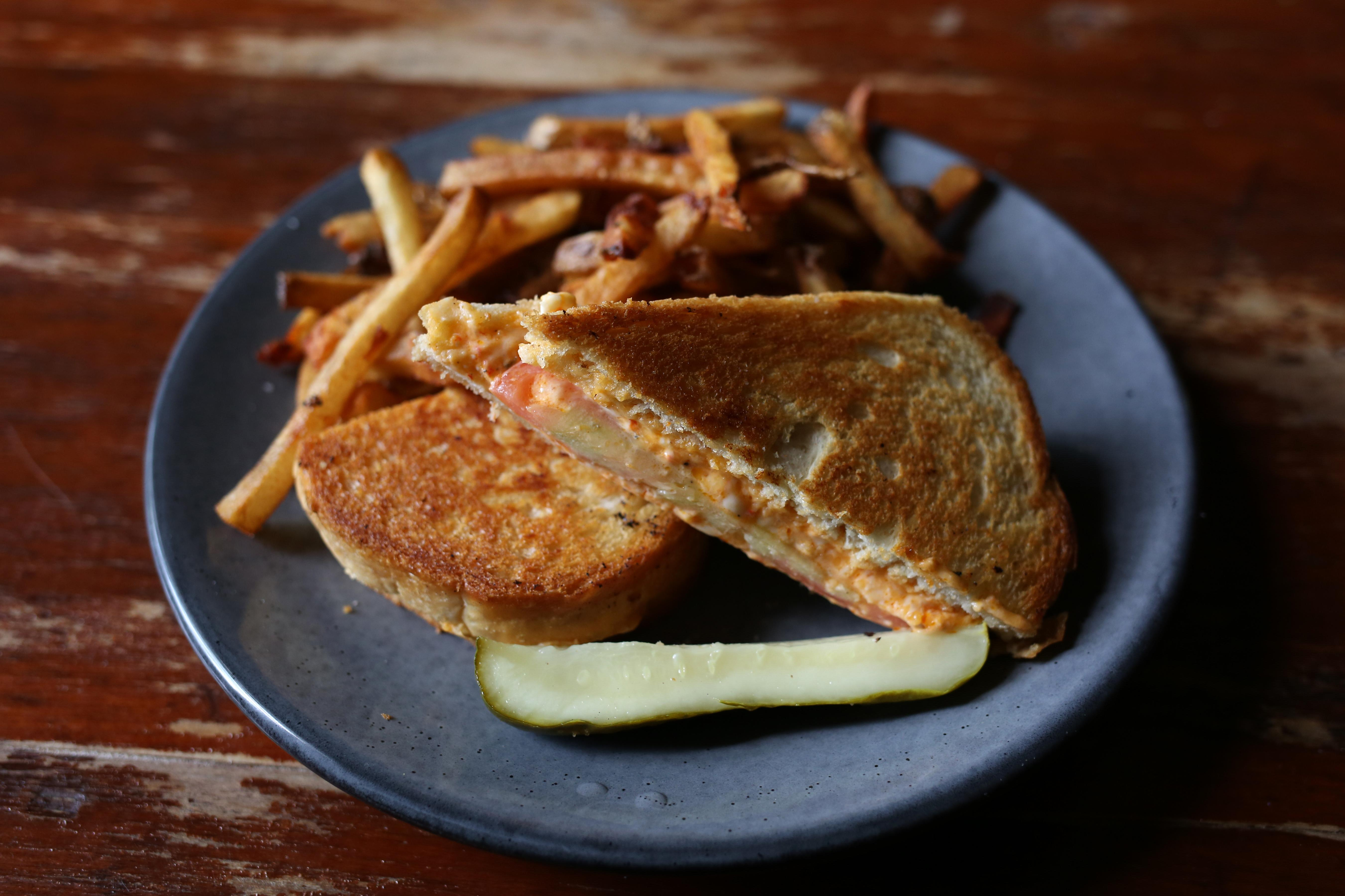 The pimento grilled cheese sandwich is a mouthful of comfort and indulgence in every bite.  (Amanda Andrade-Rhoades/DC Refined)