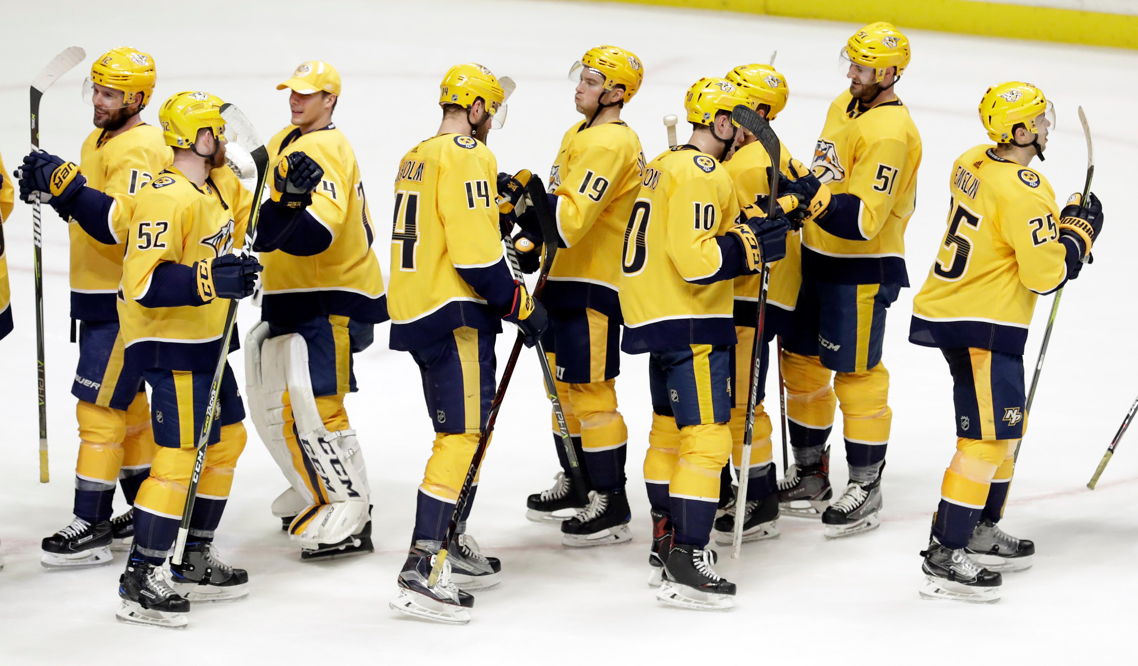 Nashville Predators players celebrate after beating the Dallas Stars 2-0 for their ninth straight NHL hockey game win Tuesday, March 6, 2018, in Nashville, Tenn. (AP Photo/Mark Humphrey)