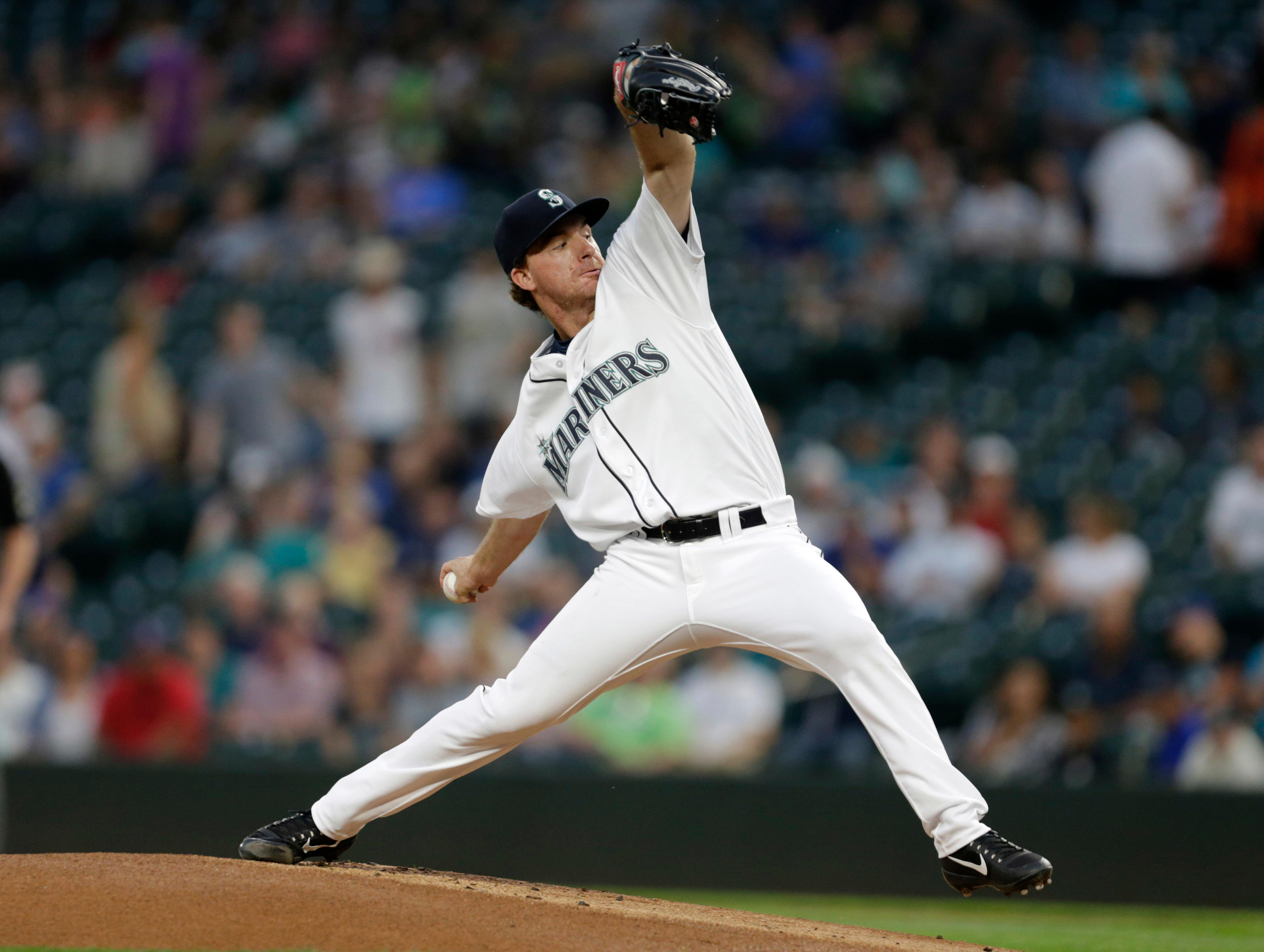 Seattle Mariners starting pitcher Andrew Moore works against the Houston Astros during the first inning of a baseball game Wednesday, Sept. 6, 2017, in Seattle. (AP Photo/John Froschauer)
