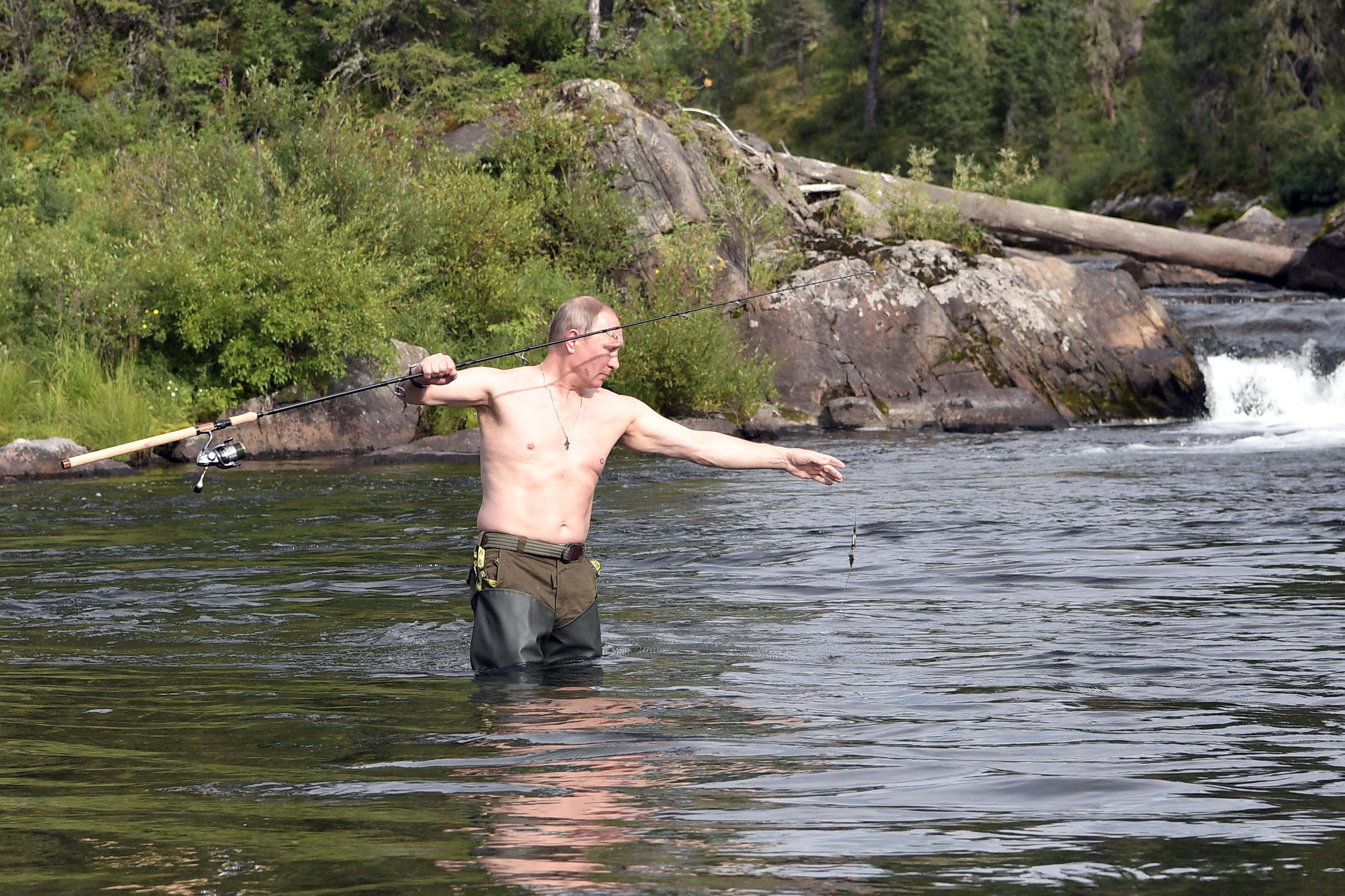 In this photo released by Kremlin press service on Saturday, Aug. 5, 2017, Russian President Vladimir Putin fishes during a mini-break in the Siberian Tyva region, a few days ago. (Alexei Nikolsky/Sputnik, Kremlin Pool Photo via AP)