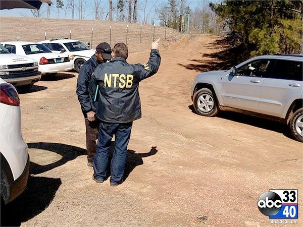 NTSB investigators on the scene of a small plane crash in Clay, Ala. that killed two people, February 15, 2014.
