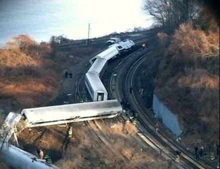 Cars from the Metro-North passenger train are scattered across the tracks.