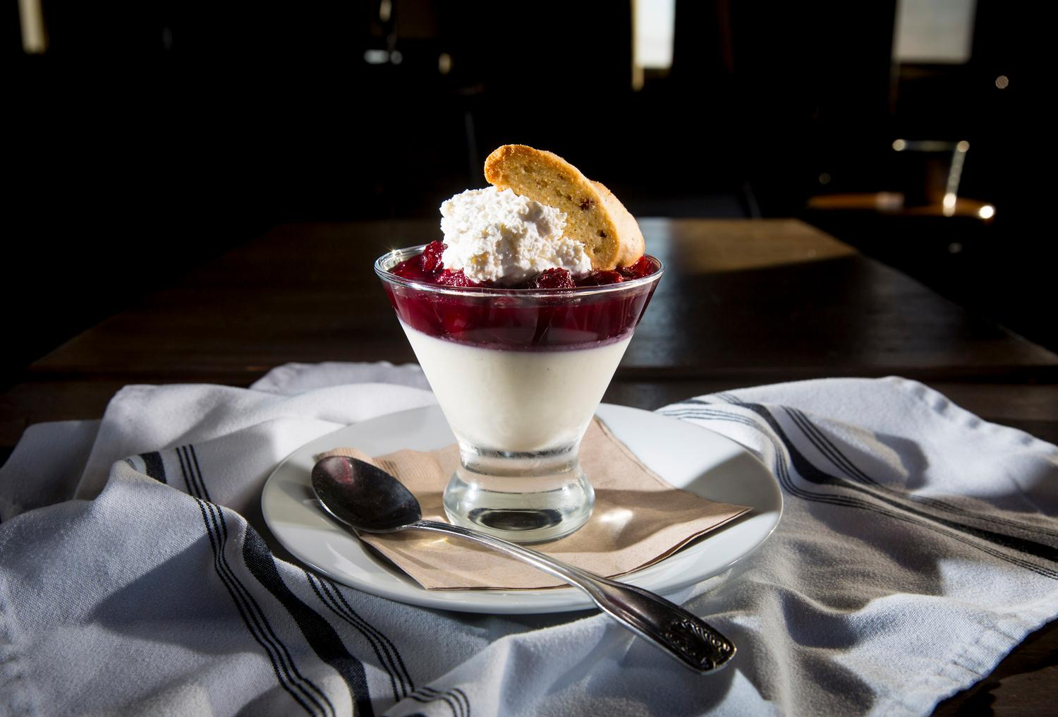 The boggy dream, with cardamom panna cotta, cranberry conserved, whipped cream, and Starvation Alley biscotti, at Pickled Fish, located at 409 Sid Snyder Dr, Long Beach, WA. (Sy Bean / Seattle Refined)