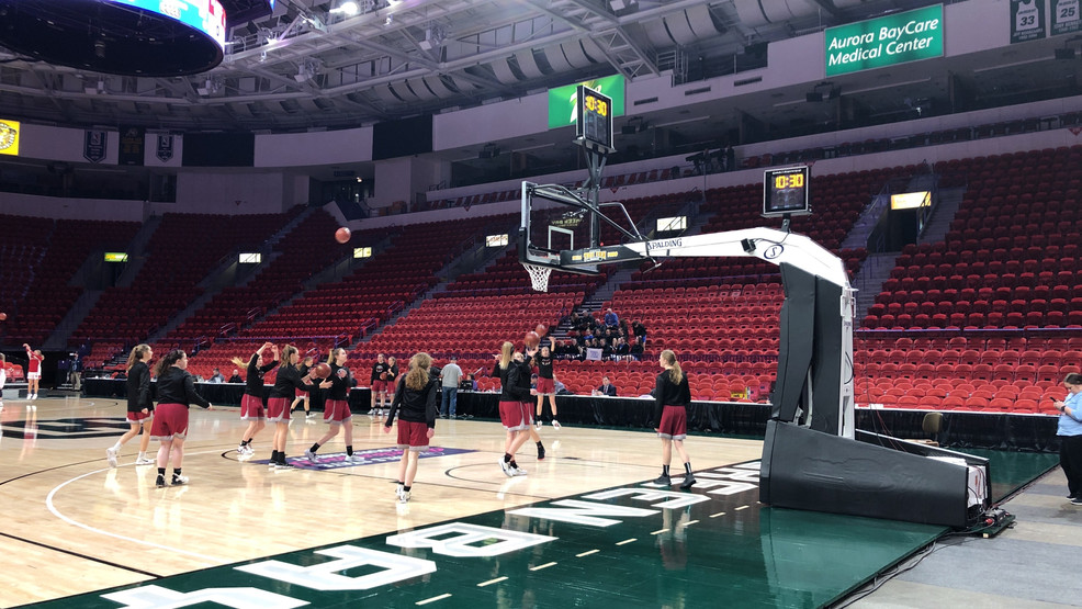 Teams warm up in front of limited fans before the girls state high school basketball tournament March 12, 2020, at the Resch Center in Ashwaubenon.