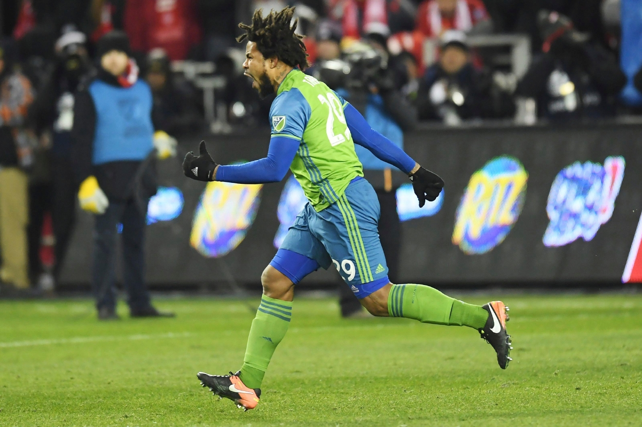 Seattle Sounders defender Roman Torres (29) celebrates his winning goal during penalty kicks at the MLS Cup soccer final against Toronto FC in Toronto, Saturday, Dec. 10, 2016. (Nathan Denette/The Canadian Press via AP)