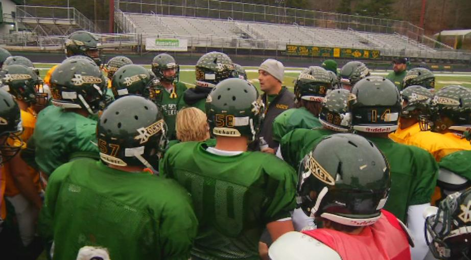 The Rockets huddle before practice leading up to the state championship game (WLOS Staff).jpg
