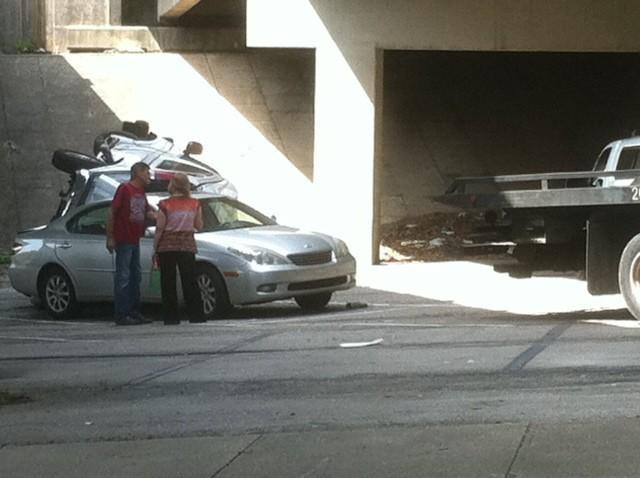 Towed car flipped over bridge 7-19-12