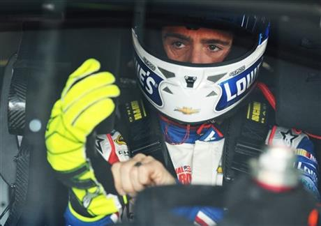 Driver Jimmie Johnson sits in his car during practice for Sunday's Aaron's 499 NASCAR auto race at Talladega Superspeedway on Friday, May 2, 2014, in Talladega, Ala.