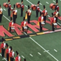 Members of UMD marching band kneel during national anthem before Terps' football game