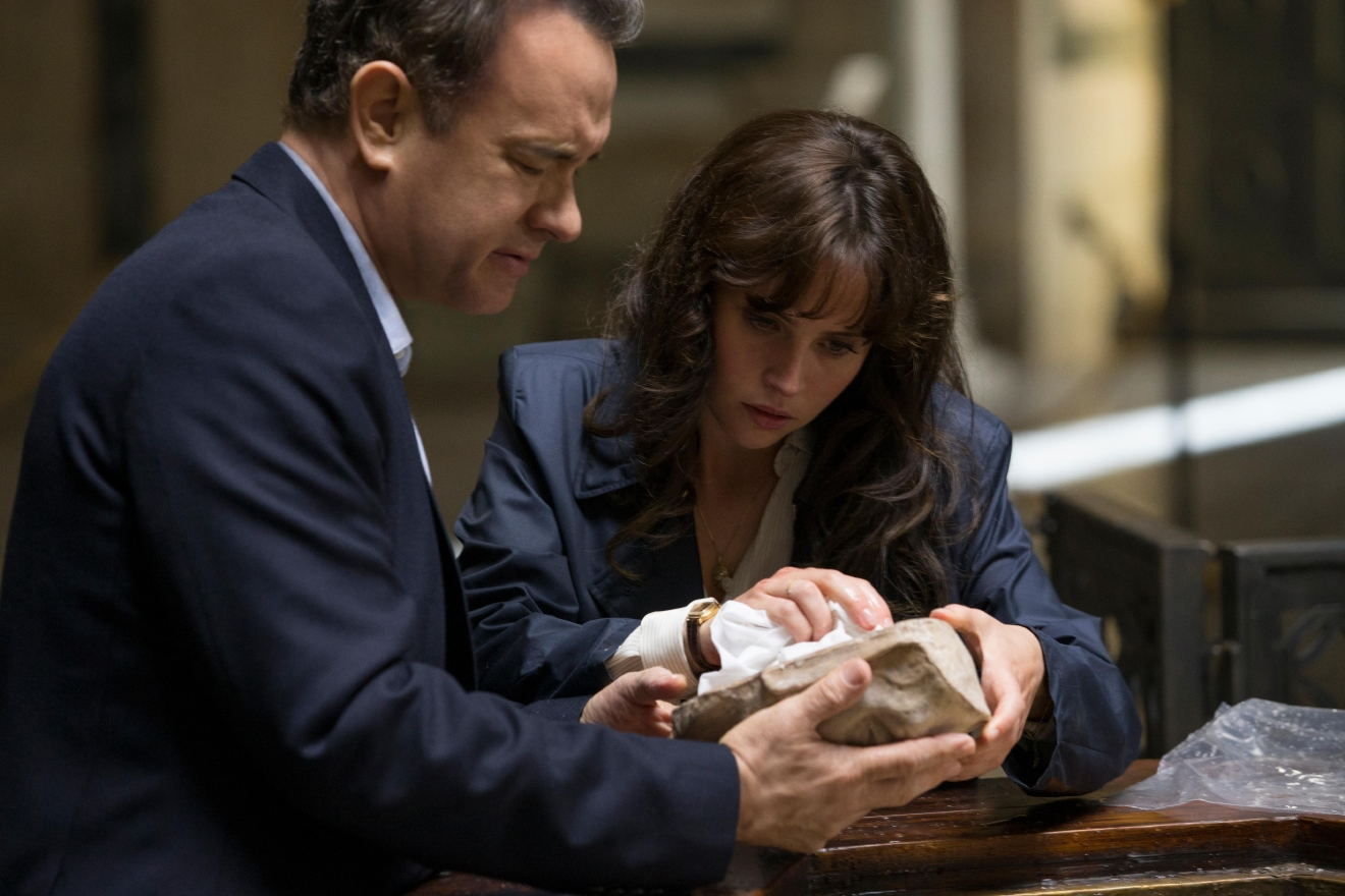 "Langdon (Tom Hanks) and Sienna (Felicity Jones) discover Dante's Death Mask in the Baptistry in Columbia Pictures' ""Inferno."""