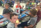 Students eat apples at Southern Door Elementary School Oct. 12, 2017.