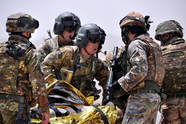 U.S. soldiers gather information from Italian soldiers about a simulated casualty during a routine clearance patrol and medical evacuation demonstration for a visiti from International Security Assistance Force Chief of Staff Lt. Gen. Giorgio Battisti.