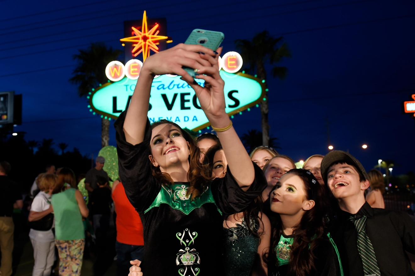 "Dancers from the Sharon Lynn Academy of Irish Dance take a photo as the ""Welcome to Fabulous Las Vegas"" sign is turned green in honor of St. Patrick's Day Thursday, March 16, 2017. (Sam Morris/Las Vegas News Bureau)"
