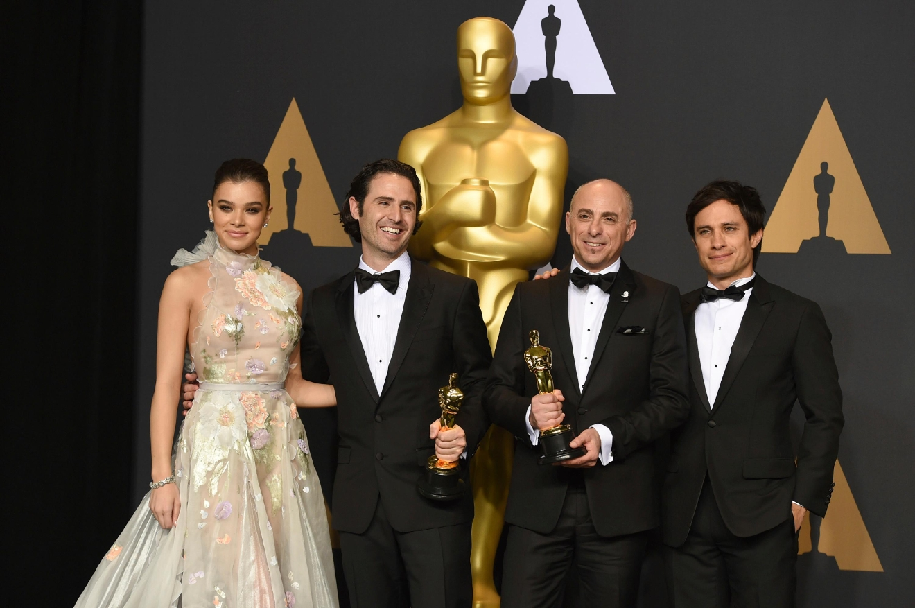 "Alan Barillaro, second from left, and Marc Sondheimer, winners of the award for best animated short film for ""Piper"", pose in the press room with Hailee Steinfeld, left, and Gael Garcia Bernal, right, at the Oscars on Sunday, Feb. 26, 2017, at the Dolby Theatre in Los Angeles. (Photo by Jordan Strauss/Invision/AP)"