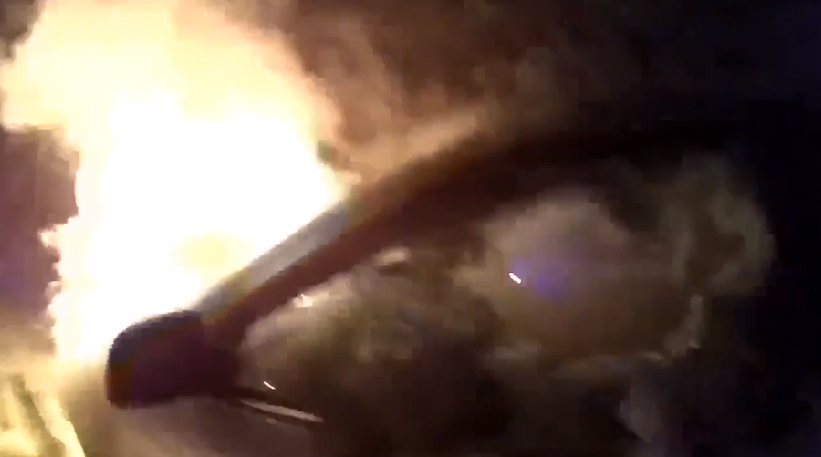 WATCH: Bodycam shows officer pulling woman from burning car Friday, January 20, 2016. (Spokane Police Department)