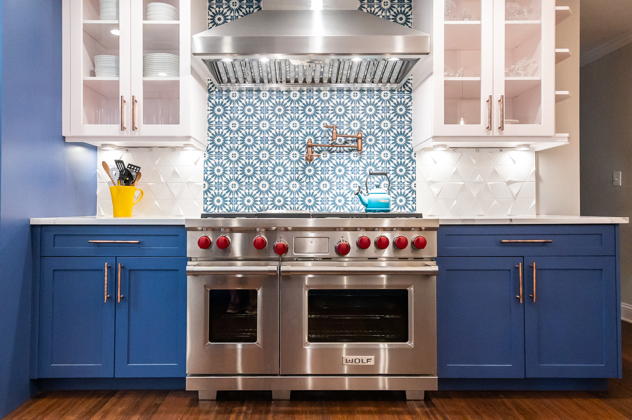 "The cooking range is a 48"" Wolf Dual Fuel, and the hood is Zephyr Titan. The featured tile backsplash behind the range are Tiles Erizo Tangier Blue from Builder Depot. / Image: Phil Armstrong, Cincinnati Refined // Published: 6.5.20"