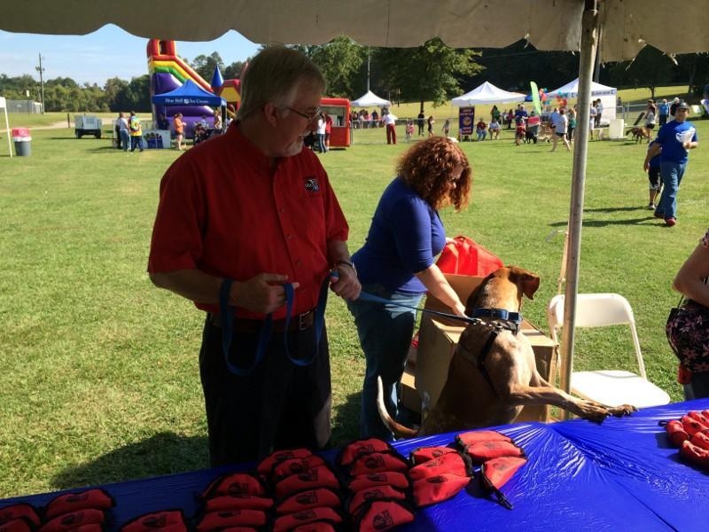 ABC 33/40 News Director Garry Kelly with his dog at WOOFstock 2013 at Veterans Park in Hoover.